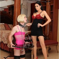 Phat black-haired Emmanuelle London puts her subby spouse in a maid garment
