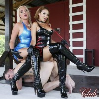 Beautiful mistresses Virgin Morgan and Kylie Rogue use a male sub as bench to sit upon