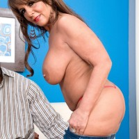 Tempting granny Cassidy has her gigantic titties massaged while a ebony stud unclothes her