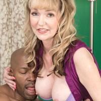 Spectacular grandmother Janee Diamond deepthroats on a BIG EBONY PENIS after exposing her gigantic boobs