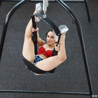 Beguiling MILF Gabriella Paltrova holds her foxy ass while fucking on a sex swing