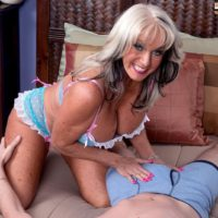 Inviting over Fifty MILF Sally D'Angelo flashing monster-sized boobies while seducing boy for sex on bed