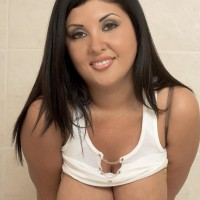 Latina MILF Daylene Rio pulls out her gigantic tits from wet tee-shirt and bra