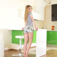 Slim platinum-blonde teen Markiza unveils her smallish boobs while adorned see thru undies