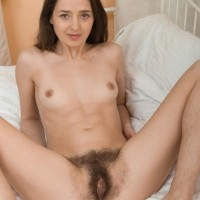 Thin brown-haired first-timer Lisa Carry sliding underwear over butt to expose hairy honeypot