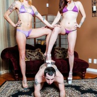 Gawky nymphs Sophia and Lucille make a slave dude snuffle their bathing suit wearing asses