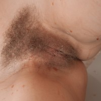 Lumbering European amateur Abigail exposing floppy boobs before unleashing fur covered coochie from underwear