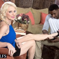 Spindly mature blond woman Cammille Austin preparing for sex with massive black penis