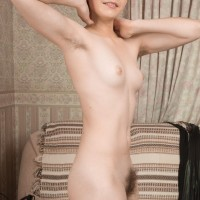 Long-legged red-haired amateur Aria wears her hair short while showing her all natural cunny