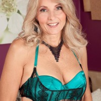 Aged light-haired Chery Leigh seduces her junior lover in alluring lingerie and nylons