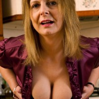 Experienced golden-haired housewife lets her big all-natural boobs free in her kitchen