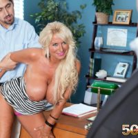 Aged ash-blonde woman Annellise Croft flashing massive boobies in front of cuckold