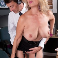 Senior blonde gal Laura Layne seducing sex from co-worker in her work place