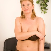 Middle elder lady ditching skirt and lingerie to model nude at office place desk