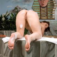 MILF model Leenuh Kai displaying foxy butt in g-string panties before freeing cootchie