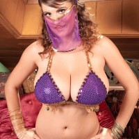 MILF pornstar Valory Irene strutting temptingly fully clothed in harem female uniform