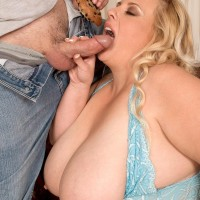 Plus sized fair-haired girl Cassie Blanca freeing huge tits before delivering BJ while munching food