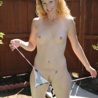 Older amateur gal takes off bikini to pose naked outdoors in back yard