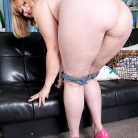 Plus sized sandy-haired solo chick Marcy Diamond uncovering massive ass from denim shorts