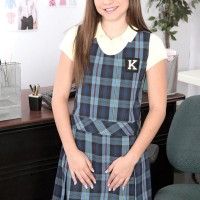 Petite schoolgirl Kharlie Stone is disrobed naked by her principal in his office place place