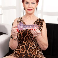 Red-haired grandma Caroline Hamsel eats and gargles her collection of sex toys in panties