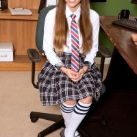 Coed Skye reveals her pointy boobs and upskirt underwear at her desk in long pigtails