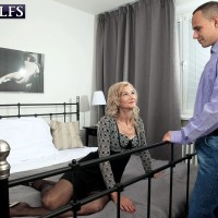 Stellar golden-haired granny Beata tempts a younger guy in a ebony microskirt and nylons