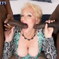Super-sexy sandy-haired grannie Seka Black deep throats on a couple of large black knobs during MMF sex