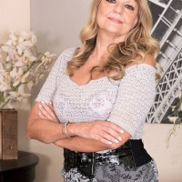 Irresistible grandmother Mia Magnusson gets nailed doggy-style after seducing a black stud