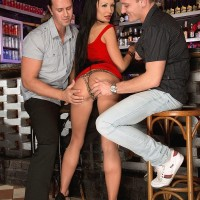 Stunning MILF Patty Michova gives two boys blowjob simultaneously in a bar