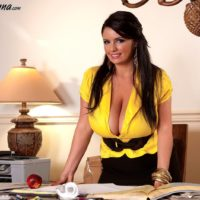 Solo chick Arianna Sinn lets out her massive breasts before eating an apple at her desk