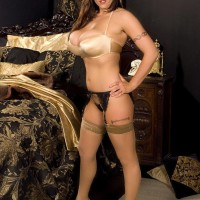 Stunner Eva Notty gets rid of a taut micro-skirt to model non naked in lingerie and pantyhose
