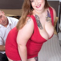 Tattooed BBW Busty Emma unveiling immense boobs and booty before giving handjob