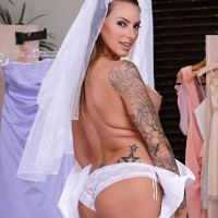 Inked bride Juelz Ventura exposes her large titties before anal sex embarks