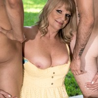 Fatty 60 plus yellow-haired Mia Magnusson seduces the gardeners outdoors for MMF sex
