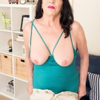 Sixty plus MILF Christina Starr uncovers her sagging breasts as she gets fully nude