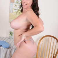Aged dark-haired woman uncovering humungous all-natural breasts and monster-sized butt