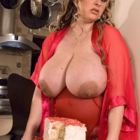 Plus-size female April McKenzie vaunting giant boobies while slurping cock and munching food