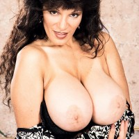 Experienced adult video starlet Busty BriAnna sets her monster-sized titties free and her shaven cunt as well