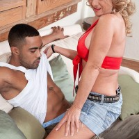 Elder blond dame Cali Houston uncovering immense tits while seducing younger man