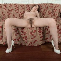 Amateur chick Amelia displays her all-natural vagina after uncovering her lil' breasts in heels