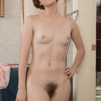 First timer chick Aria wears her hair short while showing her small boobies and total thicket