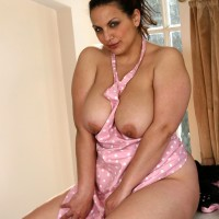 First timer housewife plays with her honeypot after baring her immense breasts in the kitchen