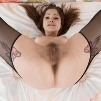 Amateur model Emanuelle showcases off her all-natural fuckbox in transparent tights and garters