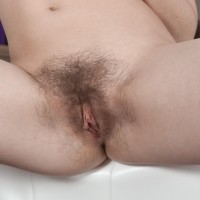 Amateur model Meggie demonstrates her tiny titties preceding to showing off her utter pubic hair