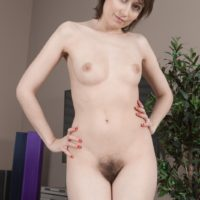 Amateur model Meggie displays her petite breasts former to showcasing her full bush