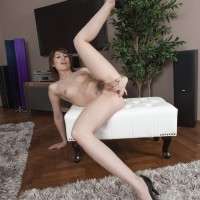 Amateur model Meggie displays her petite breasts former to showcasing her full bush