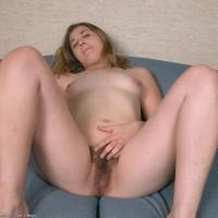 Amateur model pulls down her panties former to masturbating her wooly fuckbox