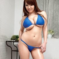 Chinese MILF Hitomi reveals her monster-sized boobs from her bathing suit top in high-heeled shoes