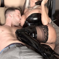 Gigantic boobed Sixty plus MILF Sally D'Angelo milks a penis in spandex boots and ebony corset